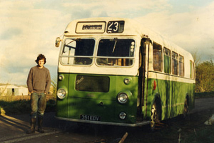 David Stooke in front of bus